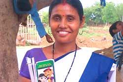 Poonam Kumari, ASHA holding Mobile Kunji