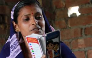Madhumala, ASHA, flaunts her Mobile Kunji