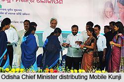 Odisha Chief Minister distributing Mobile Kunjii to ASHAs